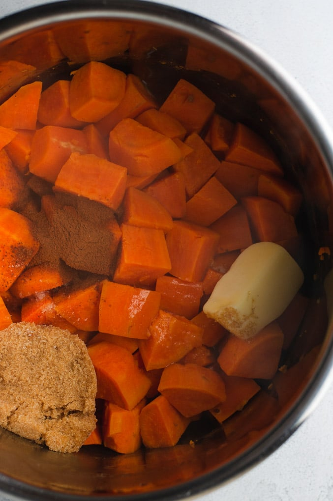Cooked cubed sweet potatoes in the Instant Pot with brown sugar, seasonings and butter.