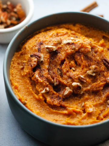 Close up of mashed sweet potatoes in a gray