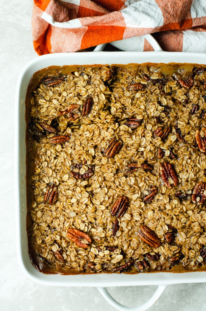 Overhead view of pecan baked oatmeal in a white baking dish