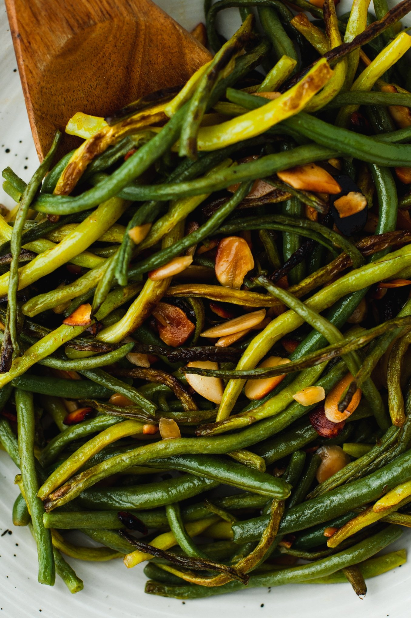 Close up view of texture of green beans and toasted almond