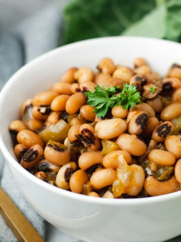 Close up of vegan black eyed peas in a white bowl