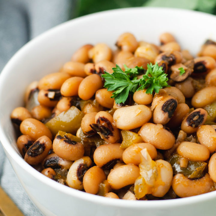Close up of black eyed peas in a white bowl