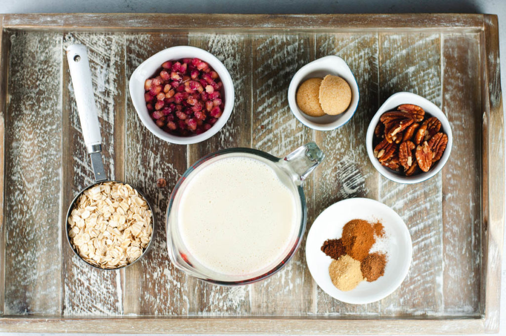 Ingredients used to make gingerbread overnight oats on a wooden table