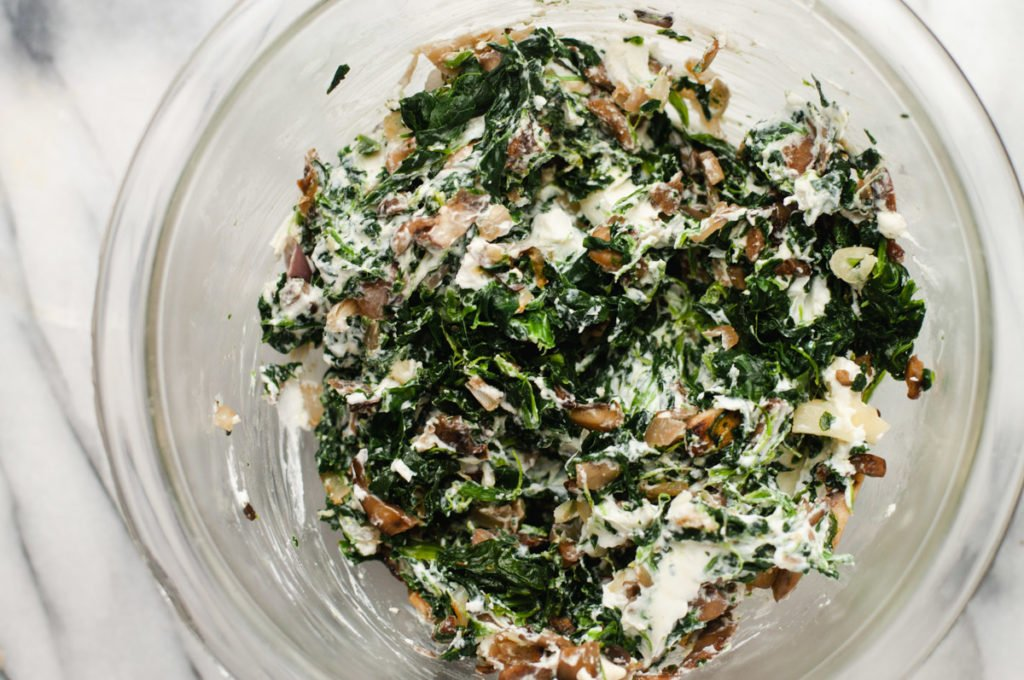 Spinach, goat cheese and mushroom filling in a glass bowl