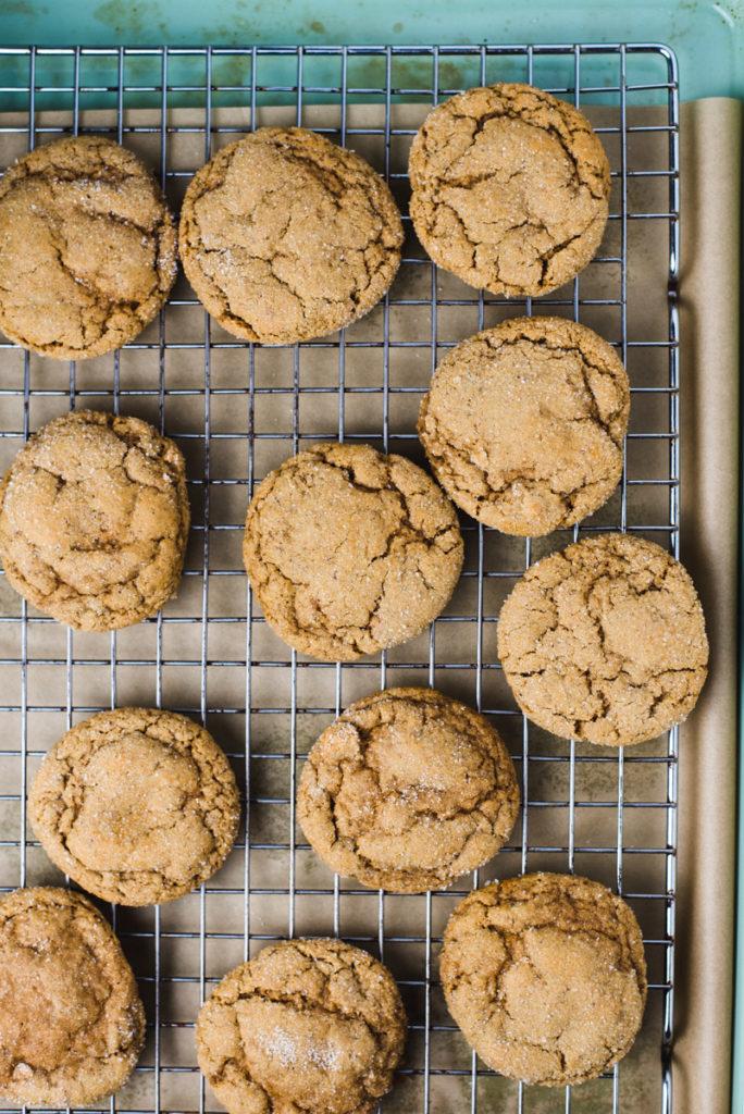 Vegan gingerbread cookies cooling on a metal cooling rack