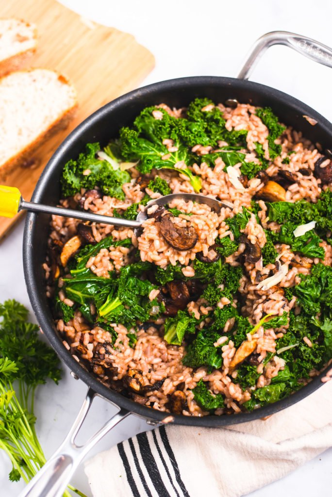 Large skillet filled with mushroom risotto
