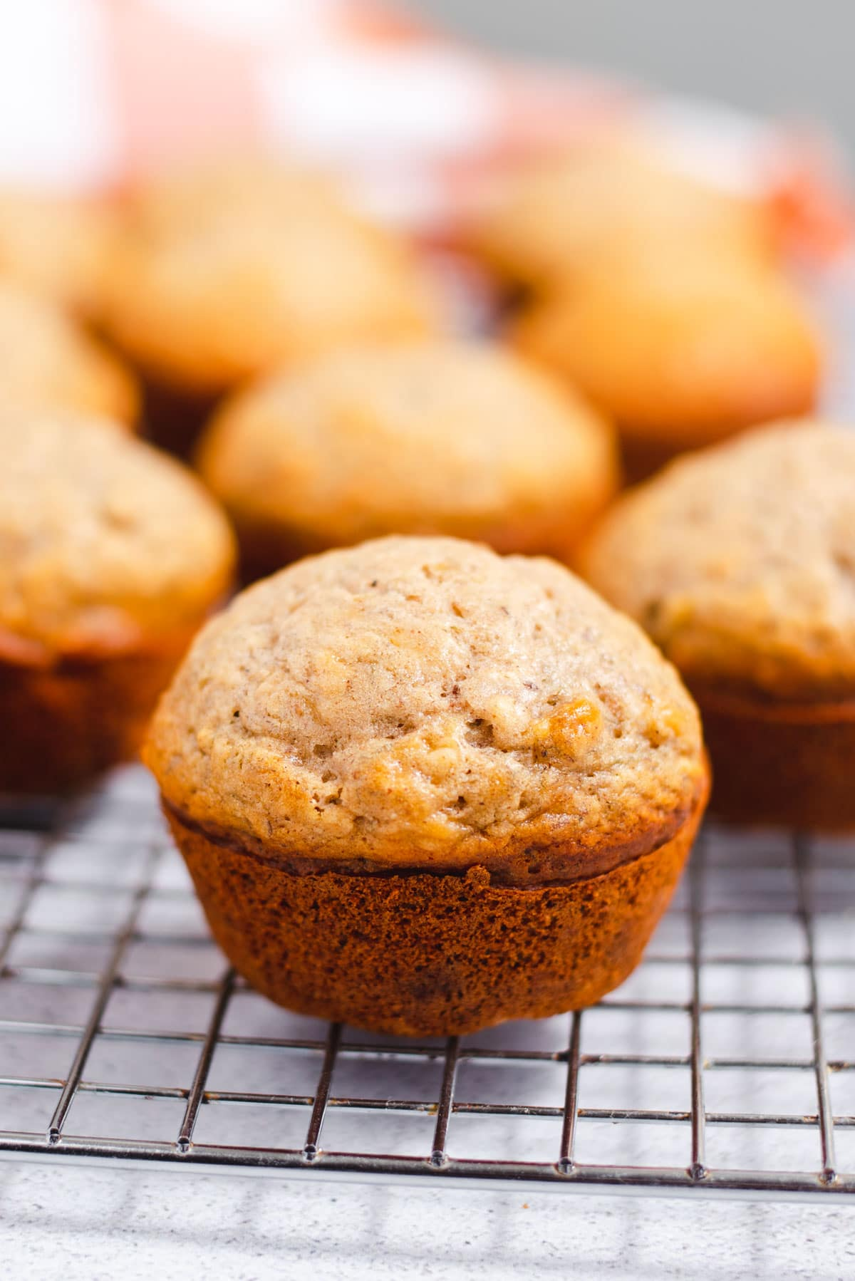 Banana muffin on a wire cooling rack