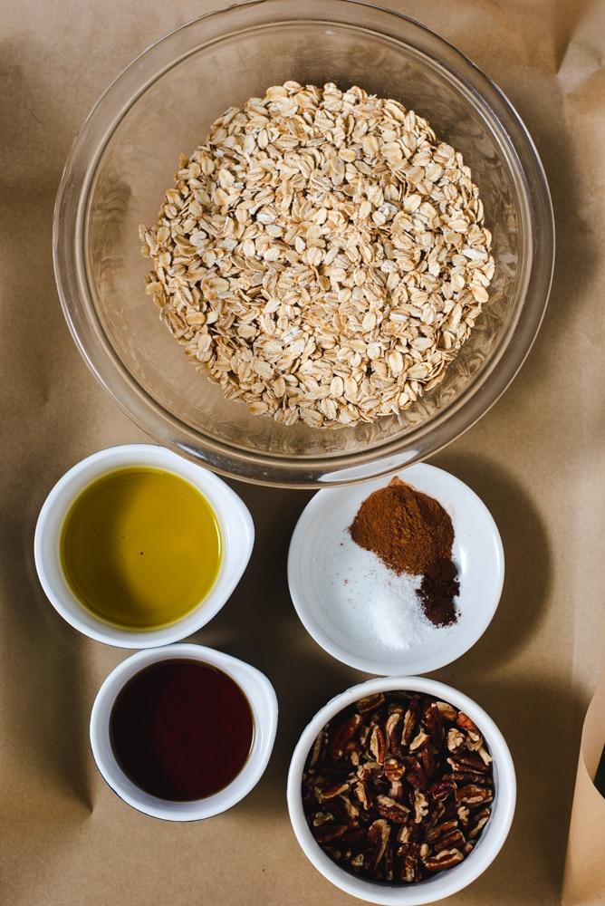 Ingredients used to make pecan granola in separate bowls