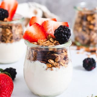 Yogurt parfait topped with strawberries and blackberries