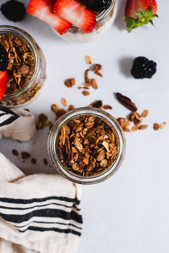 Overhead view of glass jar filled with granola