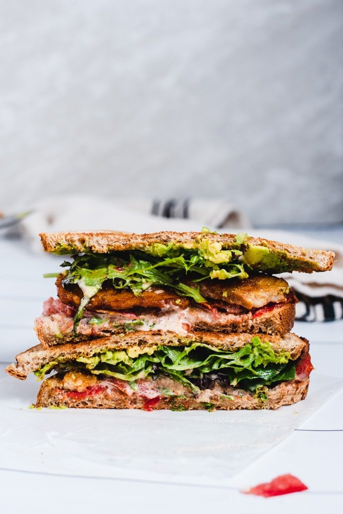 BLT sandwich sliced in half to show inside
