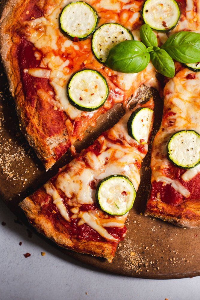 Cheese pizza topped with sliced zucchini