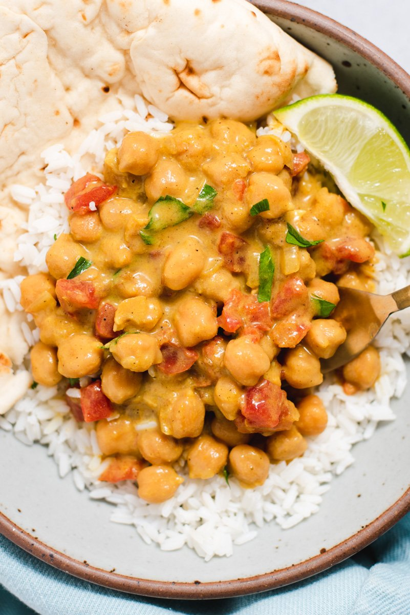 Close up of chickpea curry on white rice
