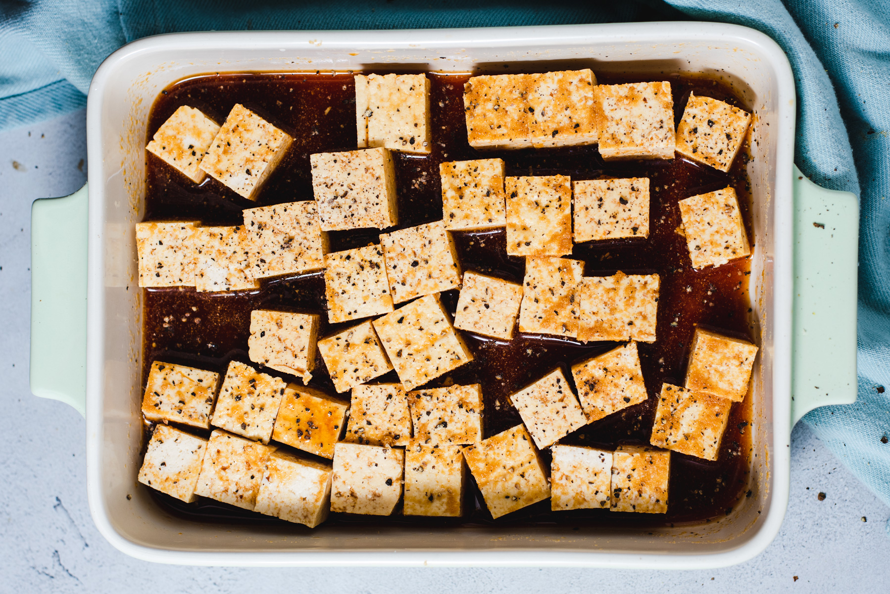 Tofu cubes in brown marinade