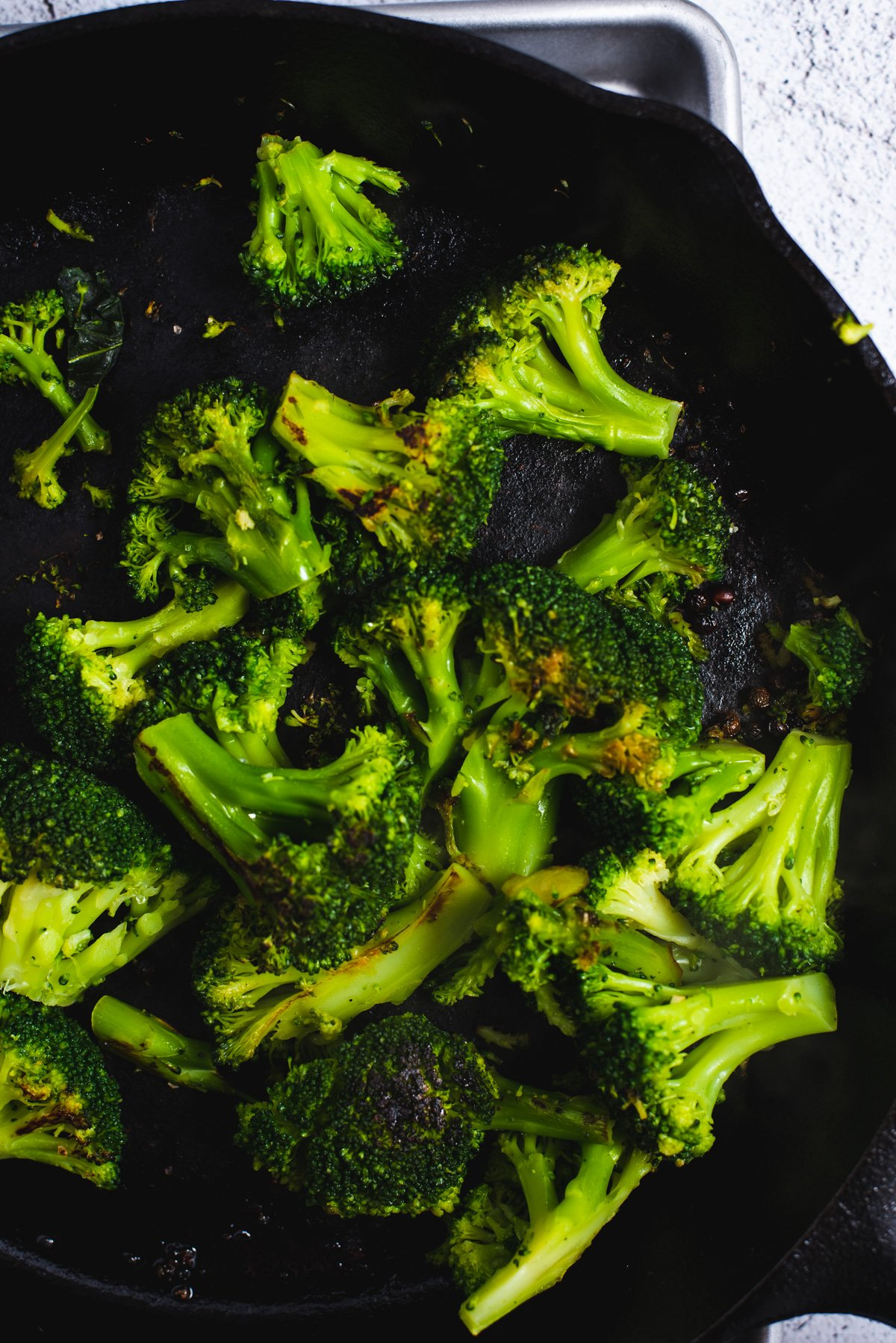 Close up of broccoli in cast iron pan