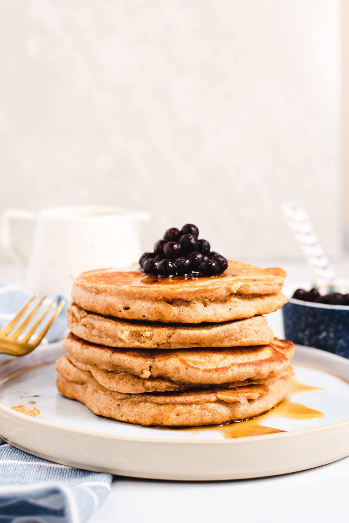 Stack of pancakes with blueberries son top