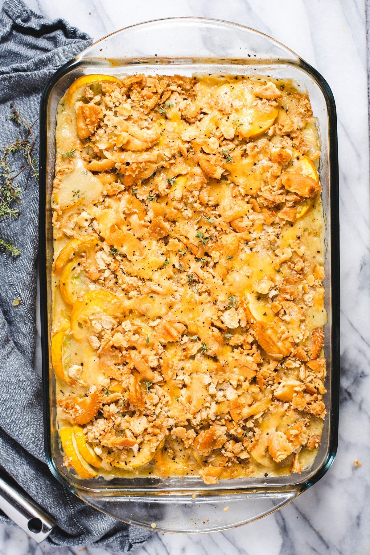 Overhead view of squash casserole in glass baking dish