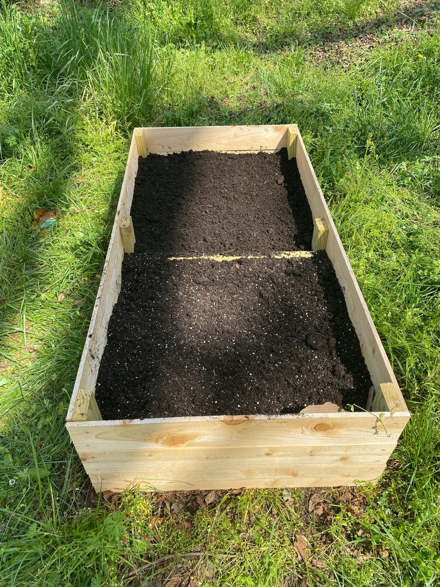 Raised garden bed filled with soil