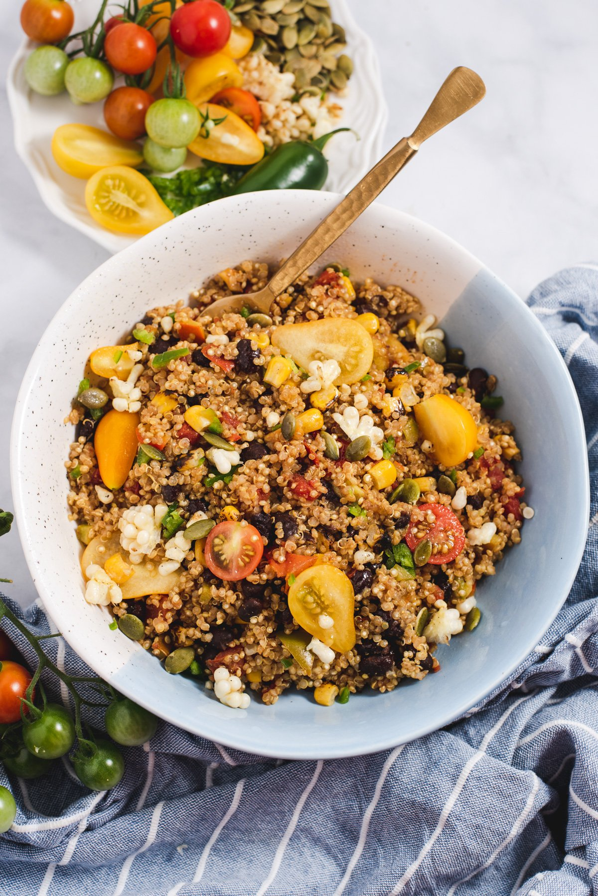 Blue and white bowl filled with quinoa salad