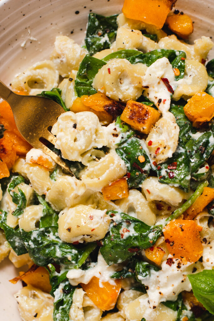 Close up of tortellini, spinach and roasted butternut squash