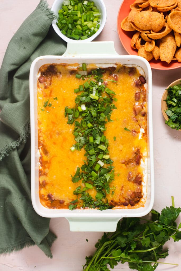 Overhead view of chili cheese dip topped with cilantro