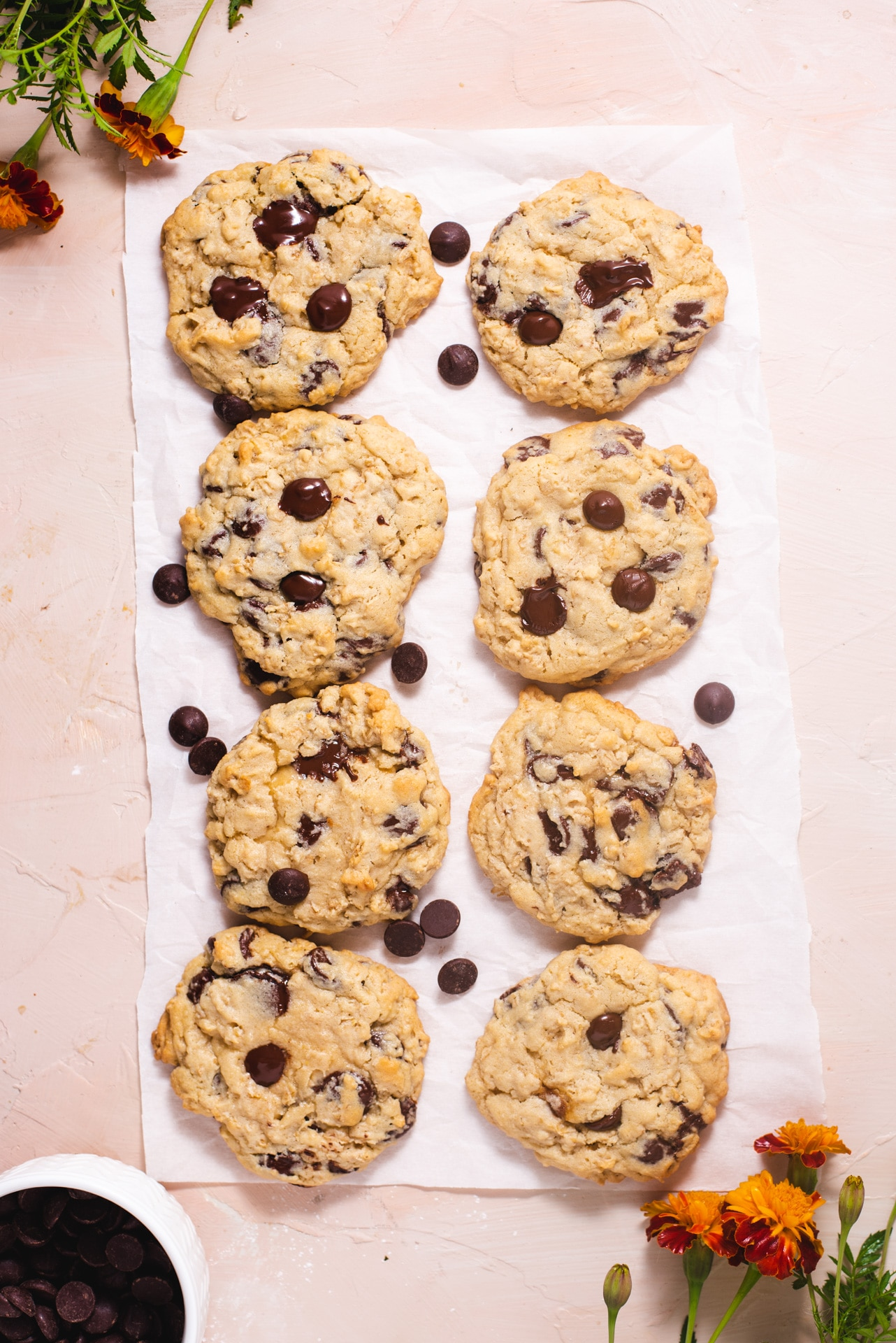 Overhead view of eight cookies on a piece of white parchment paper