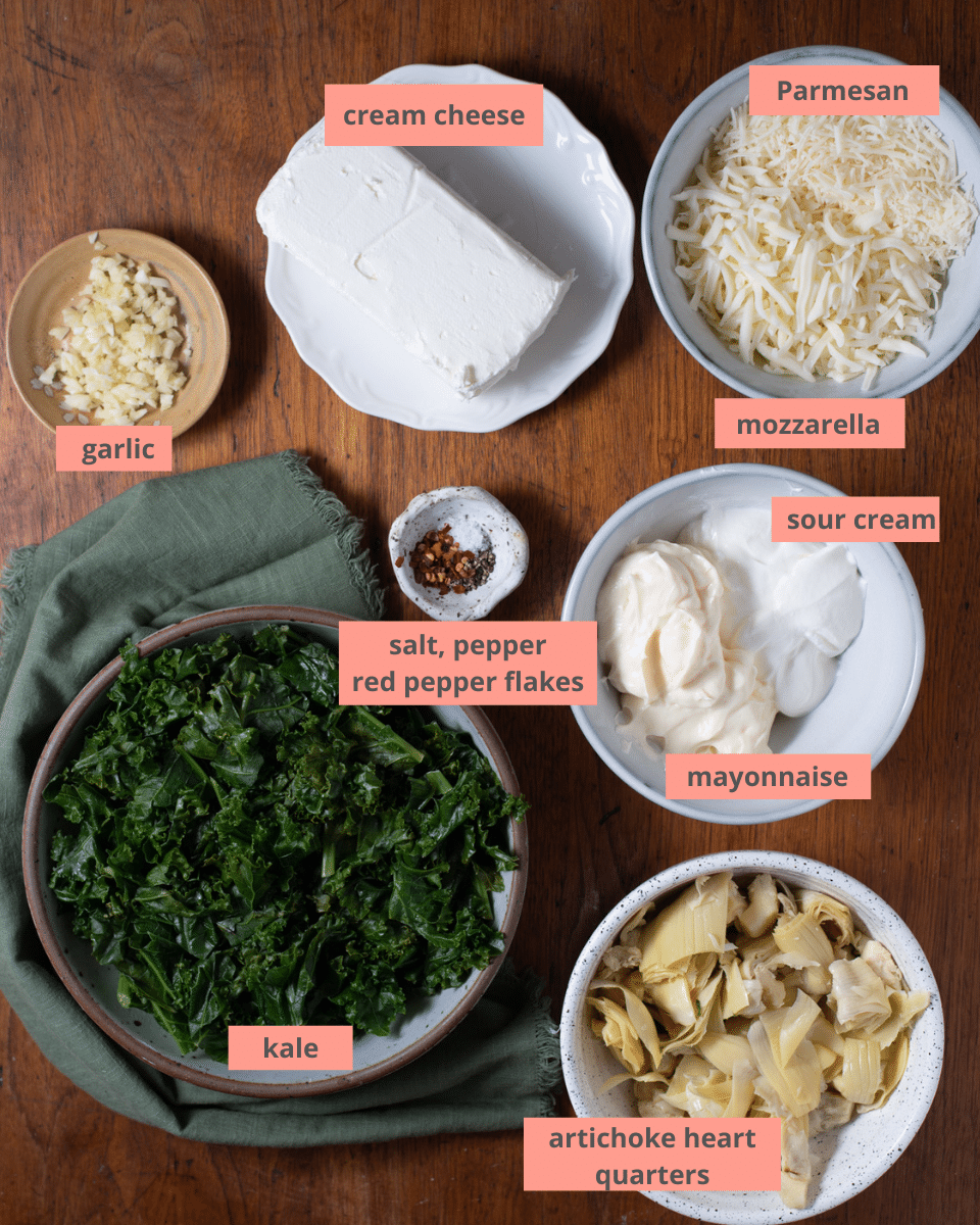Kale artichoke dip ingredients in separate bowls with labels