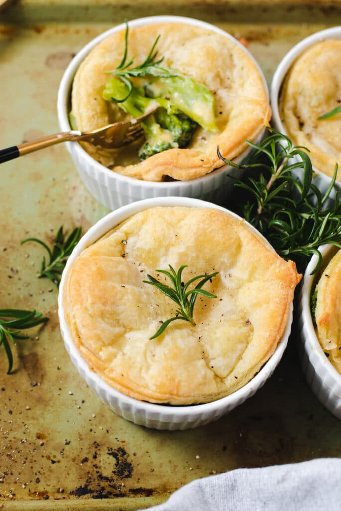 Ramekin topped with puff pastry and piece of rosemary