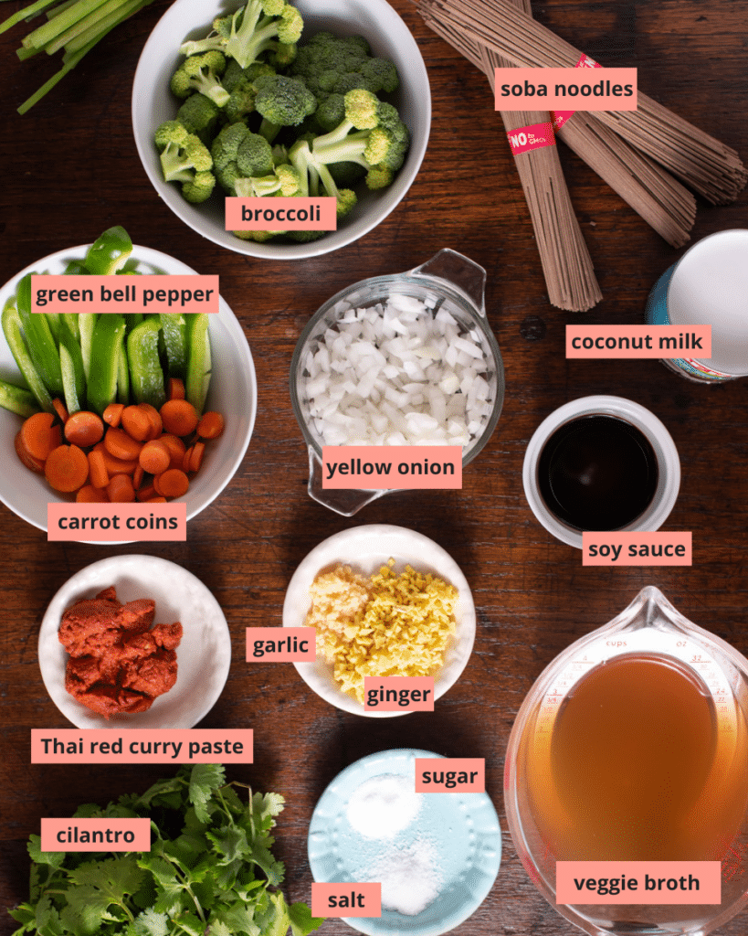 Labeled ingredients in individuals bowls on a wooden table