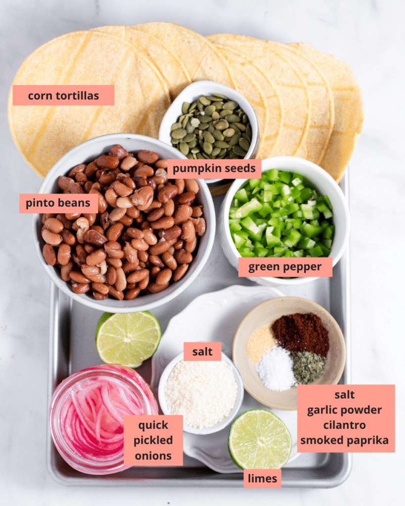 Tostada ingredients in separate containers with name labels