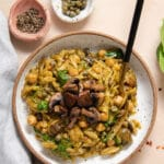 Orzo with mushrooms in white speckled bowl