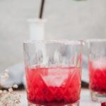Pink cocktail in a sugar rimmed glass