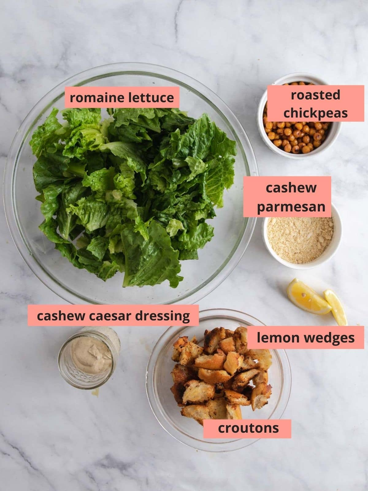 Labeled ingredients used to make caesar salad
