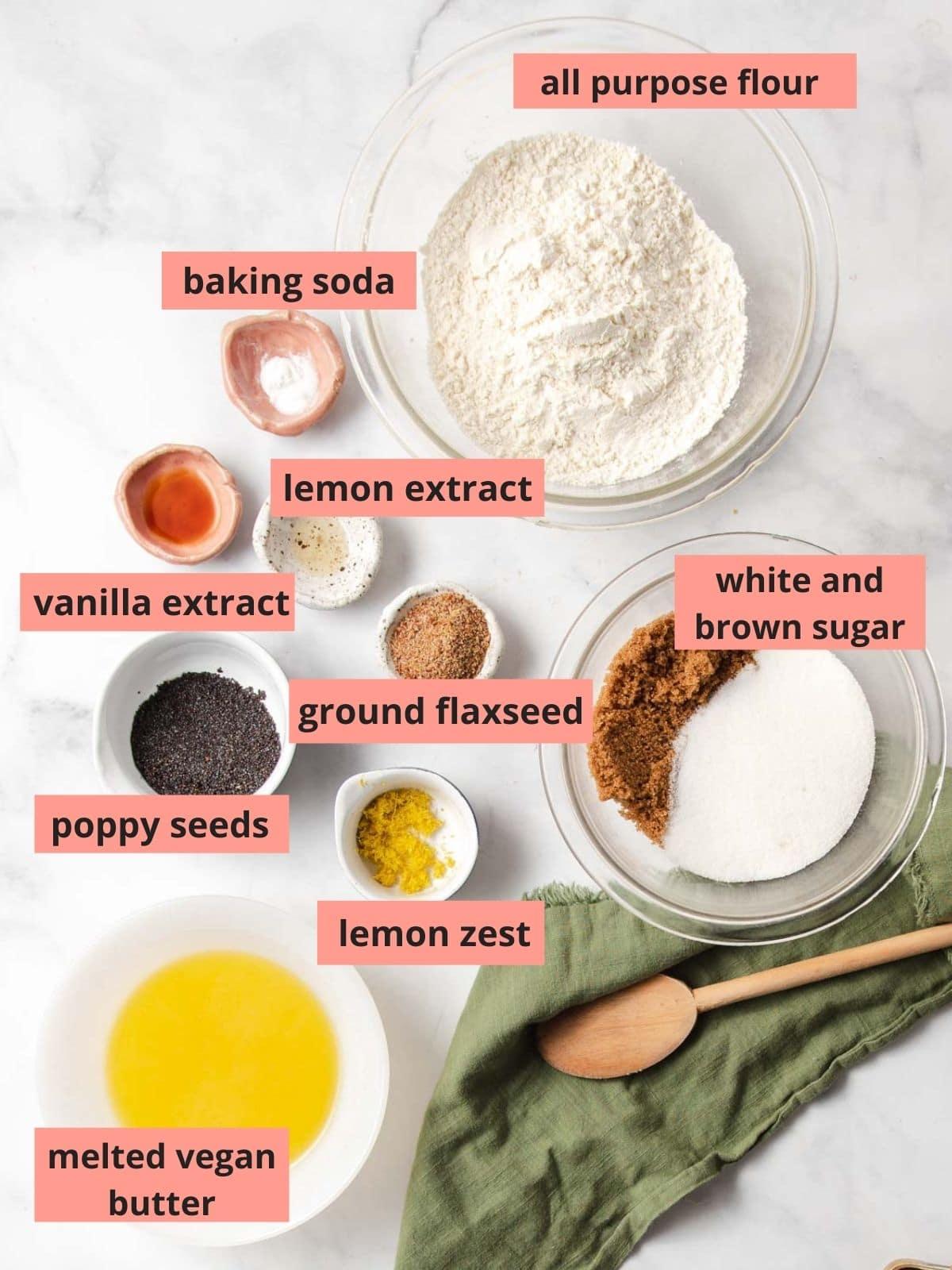 Labled ingredients used to make lemon poppy seed cookies
