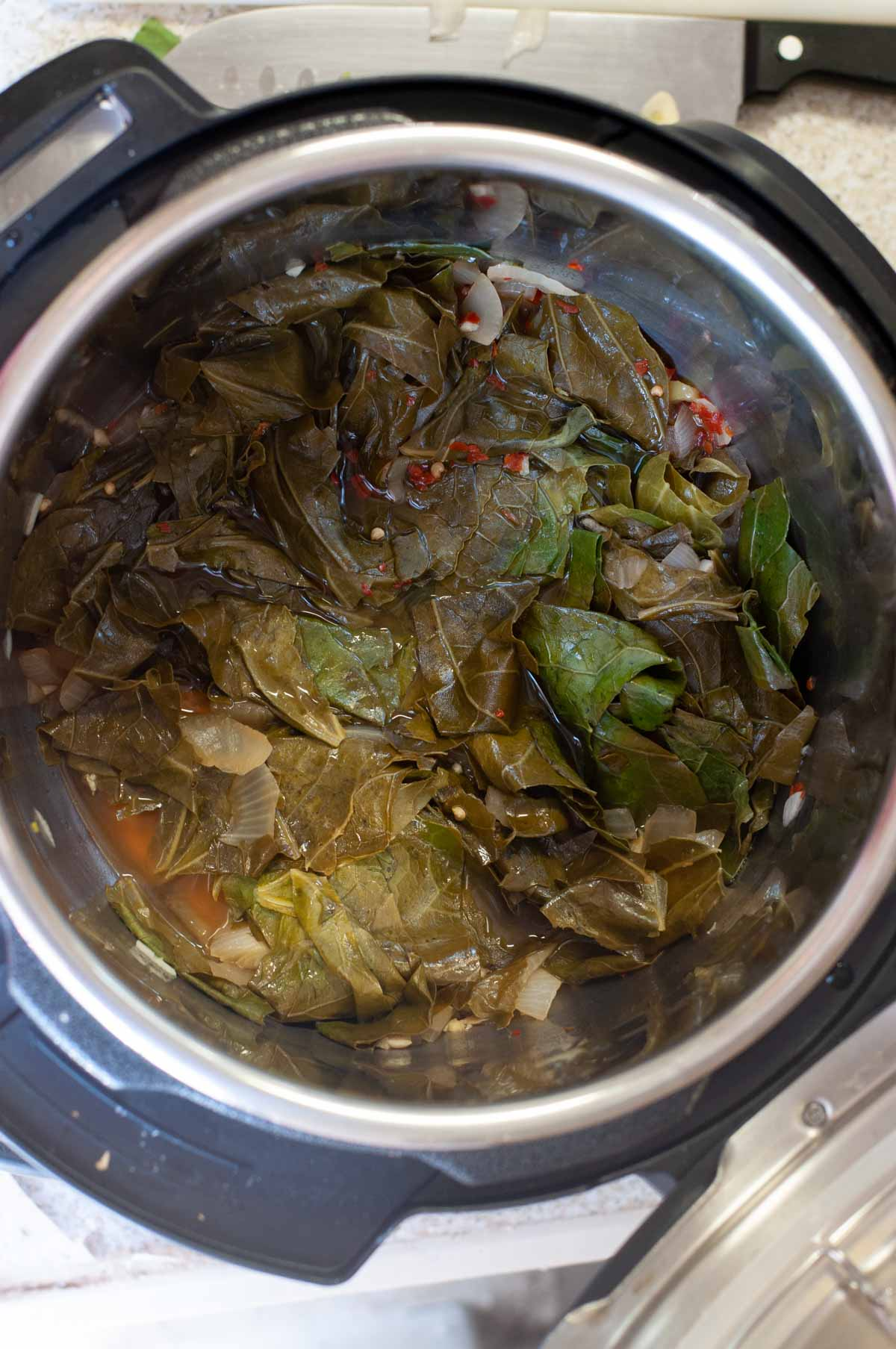 Instant Pot filled with cooked collard greens