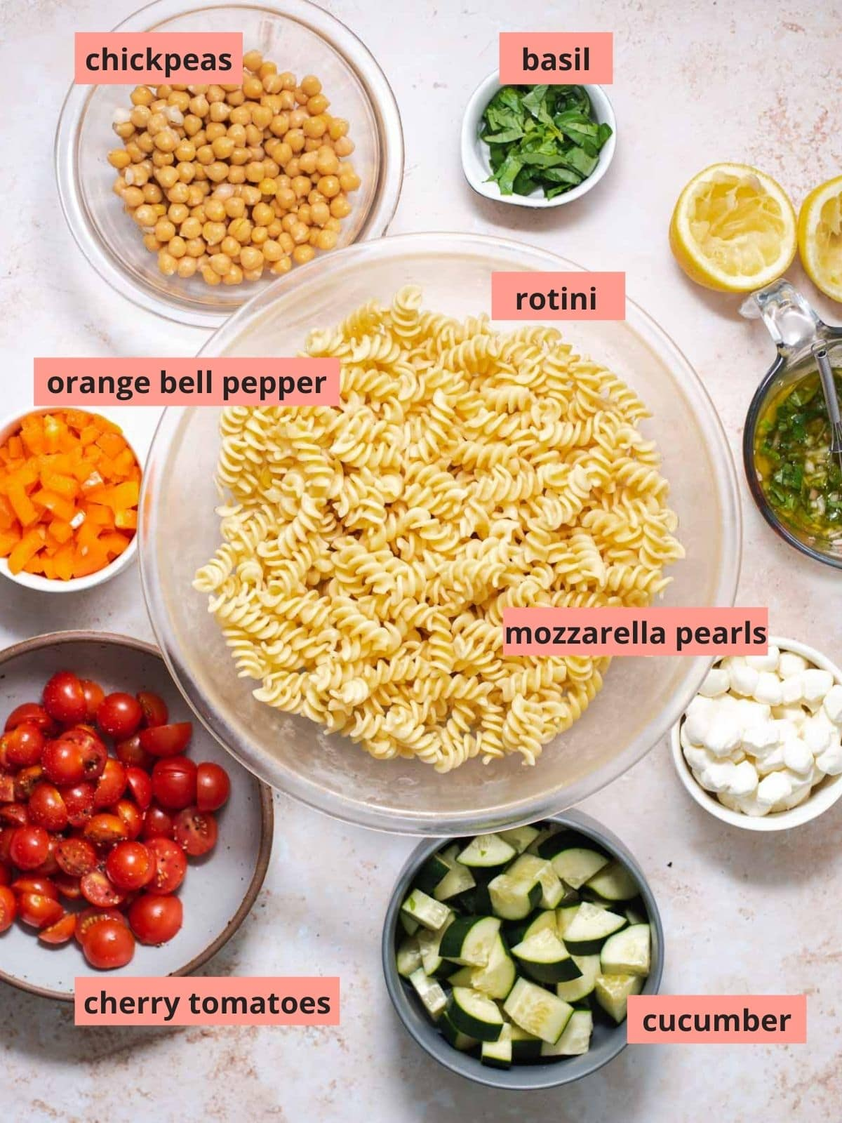 Labeled ingredients used to make pasta salad
