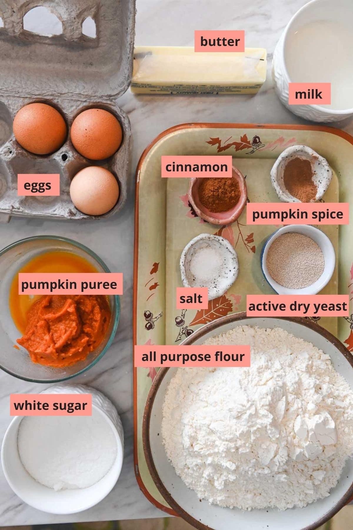 Labeled ingredients used to make pumpkin cinnamon rolls
